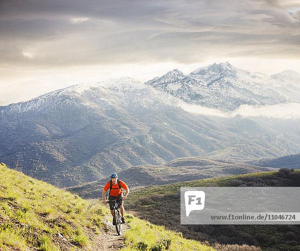 Caucasian man riding mountain bike