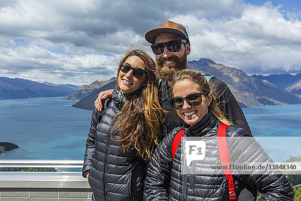 Hikers smiling at scenic viewpoint  Queenstown  Otago  New Zealand