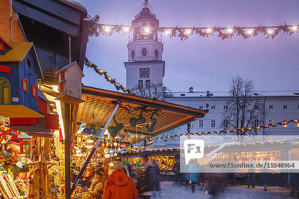 Outdoor Christmas market illuminated at night