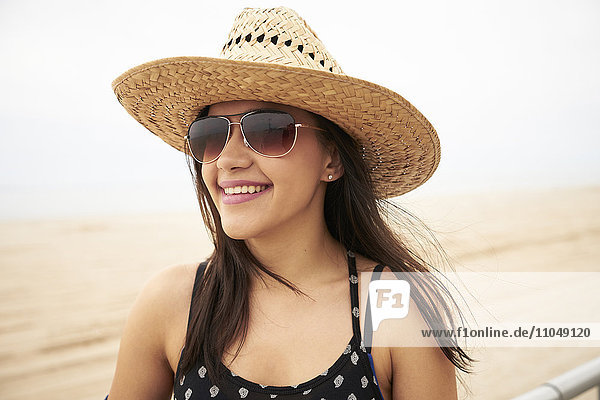 Mixed Race woman smiling on beach