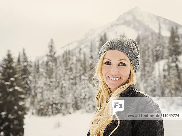 Caucasian woman smiling in snow