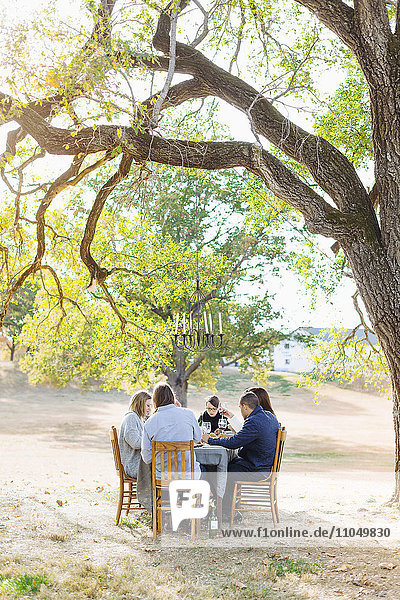 Friends eating at outdoor table