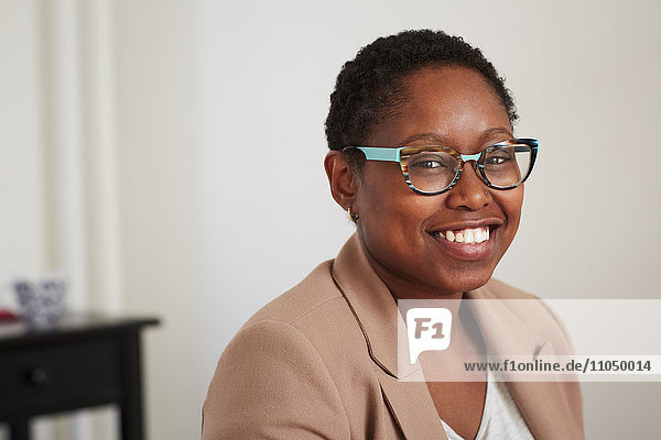 Black woman smiling indoors