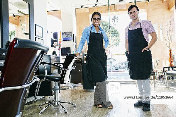 Hairdressers posing in hair salon