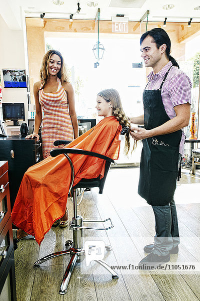 Hairdresser and customers in hair salon
