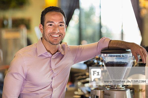 Hispanic businessman smiling in coffee shop
