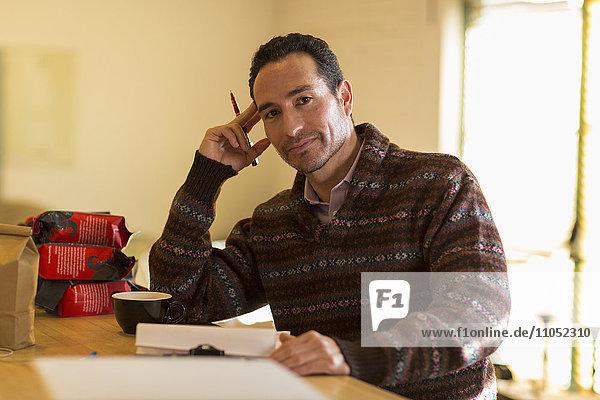 Hispanic entrepreneur taking inventory in store