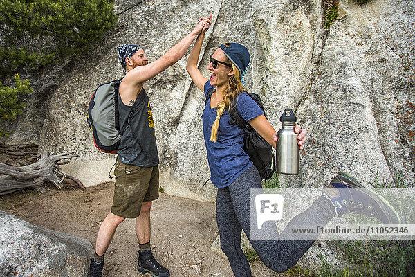 Caucasian couple high-fiving