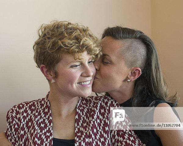 Caucasian lesbian couple kissing