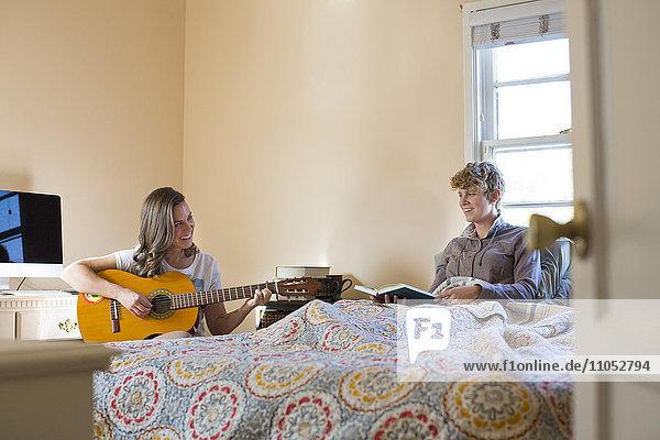 Caucasian lesbian couple relaxing in bedroom