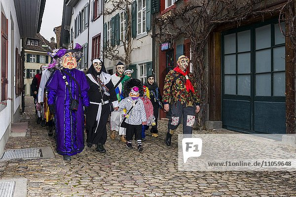 Many different groups of masked people walking through the streets of Basel  3 days and nights  Basler Fasnacht  playing music  Basel  Basel-Stadt  Switzerland  Europe