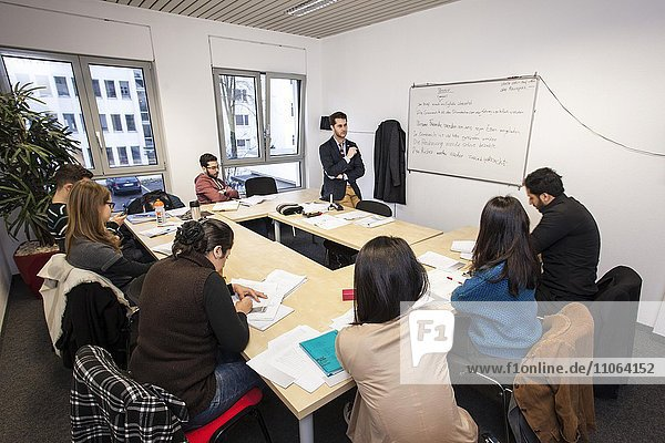Foreigners in German lessons in an international class  language class  Germany  Europe