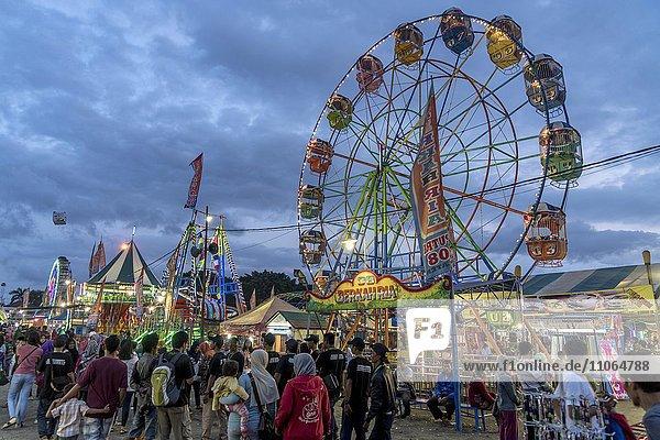 funfair with Ferris wheel in Yogyakarta  Dusk  Java  Indonesia  Asia