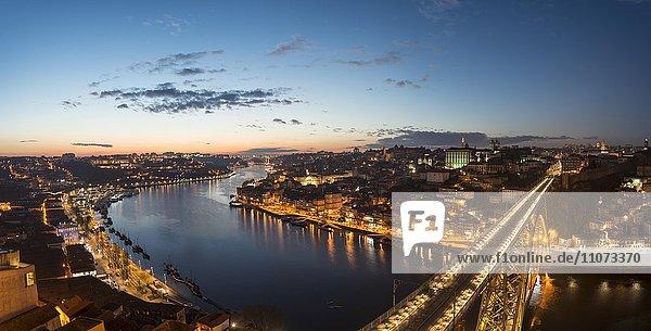 View over Porto with illuminated Dom Luís I Bridge across River Douro  dusk  Porto  Portugal  Europe