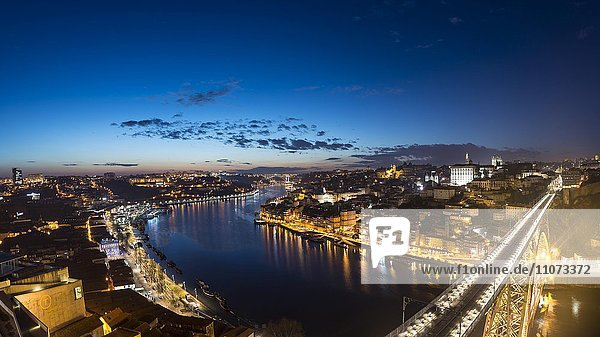 View over Porto with illuminated Dom Luís I Bridge across River Douro  dusk  Porto  Portugal  Europe