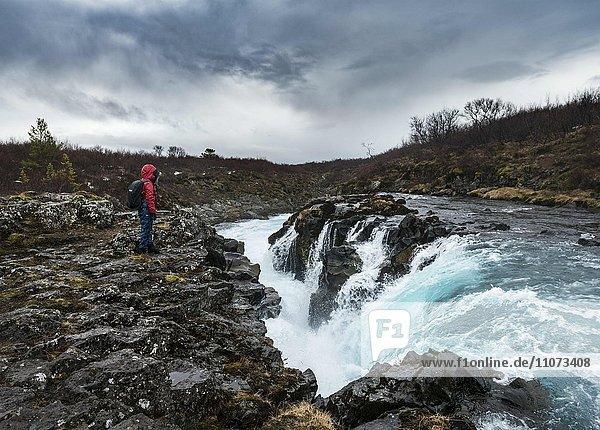 Hiker at Hlauptungufoss Waterfall  River Brúará  Golden Circle  Southern Region  Iceland  Europe