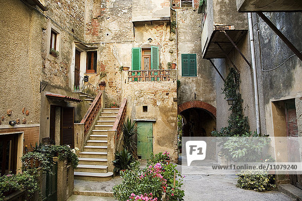 Picturesque old courtyard with stairs and balconies
