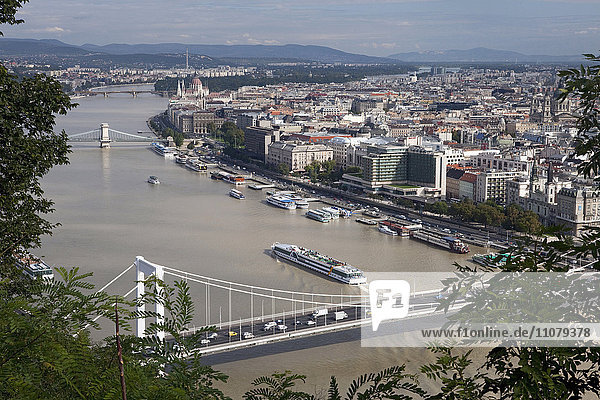 View of bridge over river with city in background