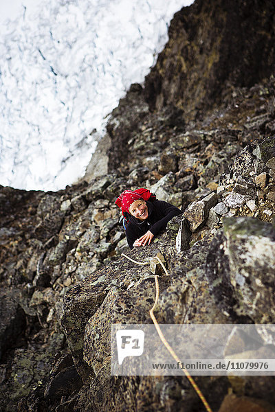 Woman climbing on cliff