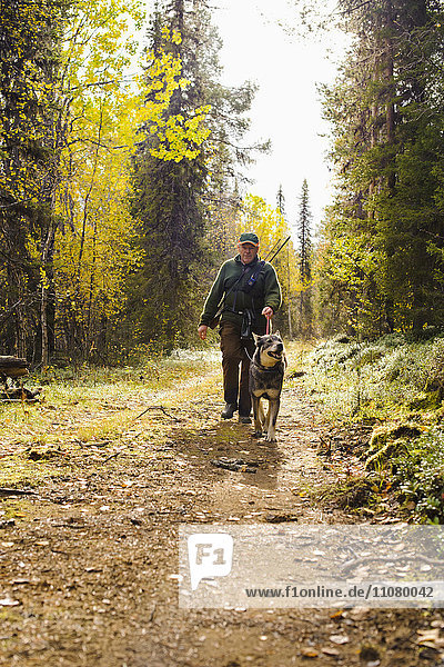 Man walking with dog in forest