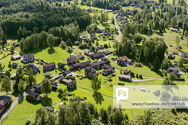 Aerial view or rural area with farm houses