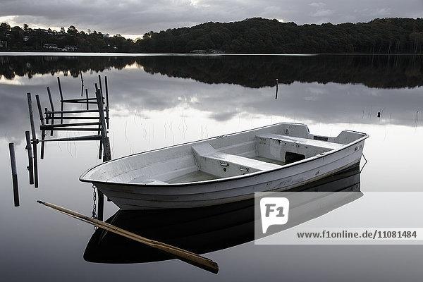 Rowboat floating on lake