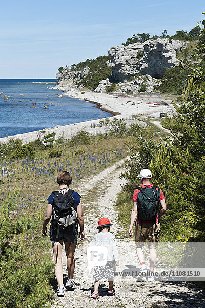 Family hiking at seaside