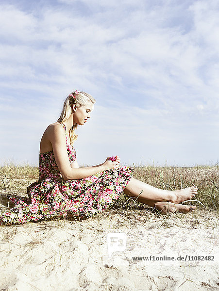 Young woman in floral dress  side view