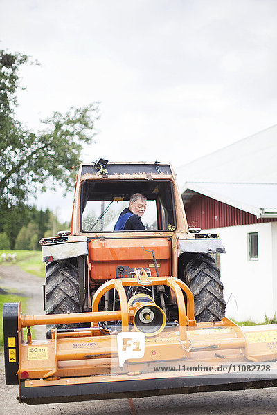 Senior man on tractor  Smaland  Sweden