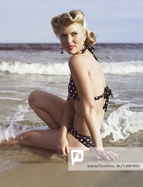 Young retro woman on beach