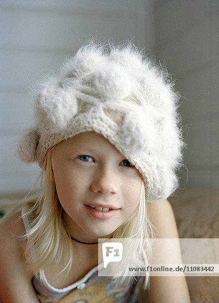 Portrait of girl wearing knit hat
