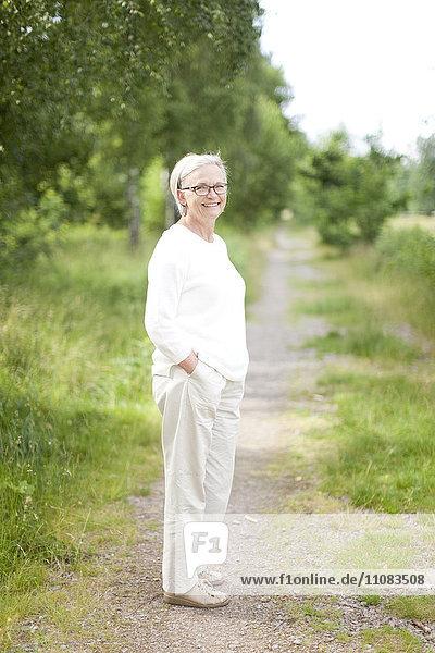Senior woman standing on path