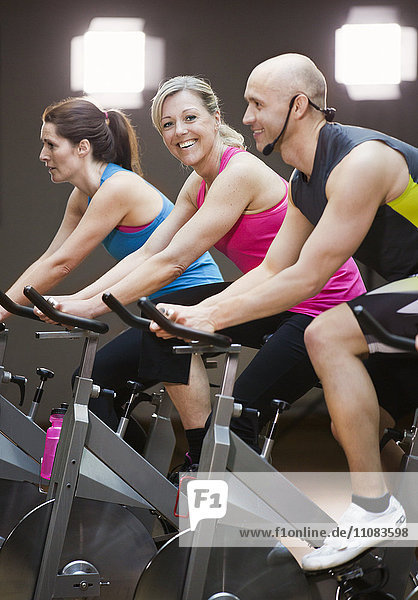 People riding exercise bikes