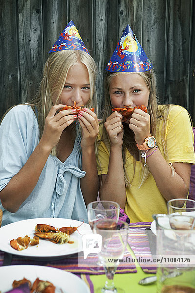 Teenage girls at crayfish party,  Sweden