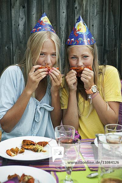 Teenage girls at crayfish party  Sweden