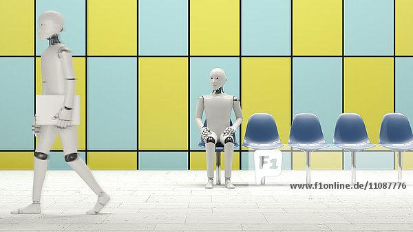Roboter sitzend auf Stuhl in der U-Bahn-Station  einer zu Fuß mit Laptop