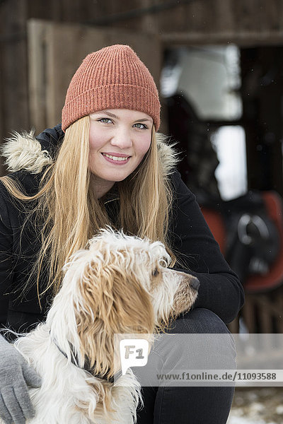 Portrait of a teenage girl with her dog  Bavaria  Germany