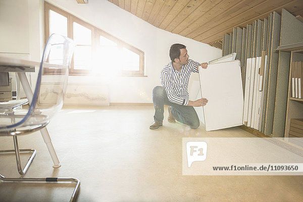 Architect searching canvas in the office  Bavaria  Germany