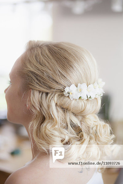 Close-up of a bride with flowers in hair