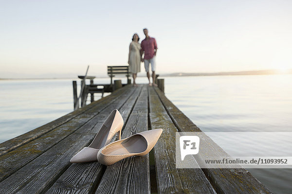 Dress shoe with mature couple standing on pier  Bavaria  Germany