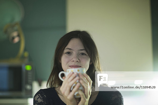 Portrait of a businesswoman having a cup of coffee in an office