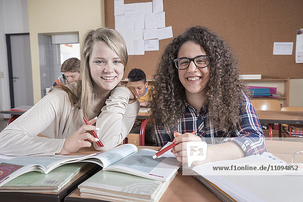University students studying and smiling in classroom  Bavaria  Germany