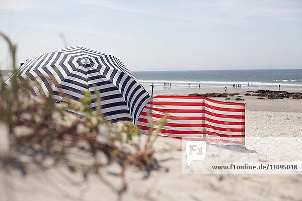 Striped Sunshade on the beach  Viana do Castelo  Norte Region  Portugal