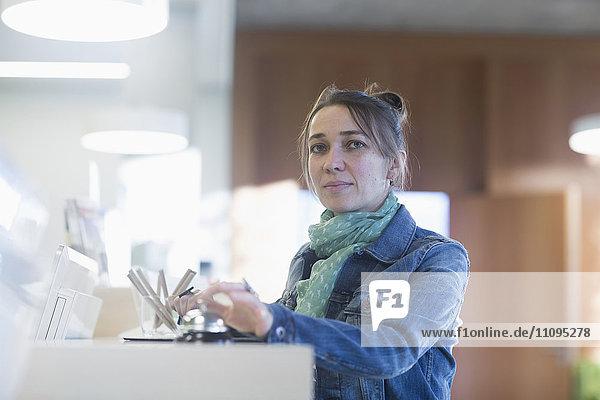 Portrait of a mature woman waiting at hotel reception  Freiburg Im Breisgau  Baden-Württemberg  Germany