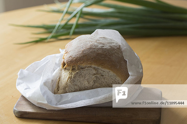Bread loaf wrapped in paper on the table  Freiburg im breisgau  Baden-württemberg  Germany