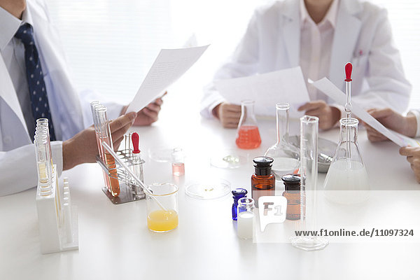 Three Scientists Researching