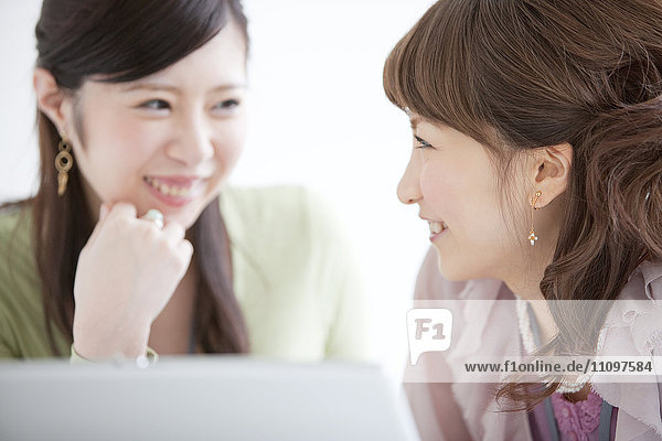 Two Women Working on Computer