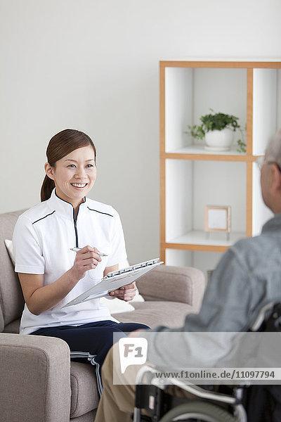 Nurse Talking To Senior Male Patient