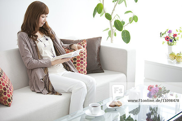 Young Woman Reading in Living Room