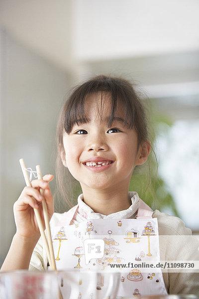 Girl holding chopsticks